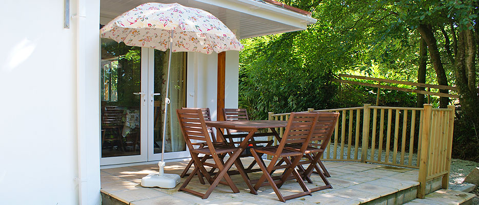 The lovely patio at Riverside Cottage, Darrynane, overlooking the fenced garden and private parking. Riverside sleeps 6