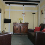 Sofa and chair plus tv in lounge of Lodge